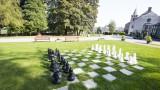 Centre de vacances Relaxhoris - Jeu d'échec dans le parc